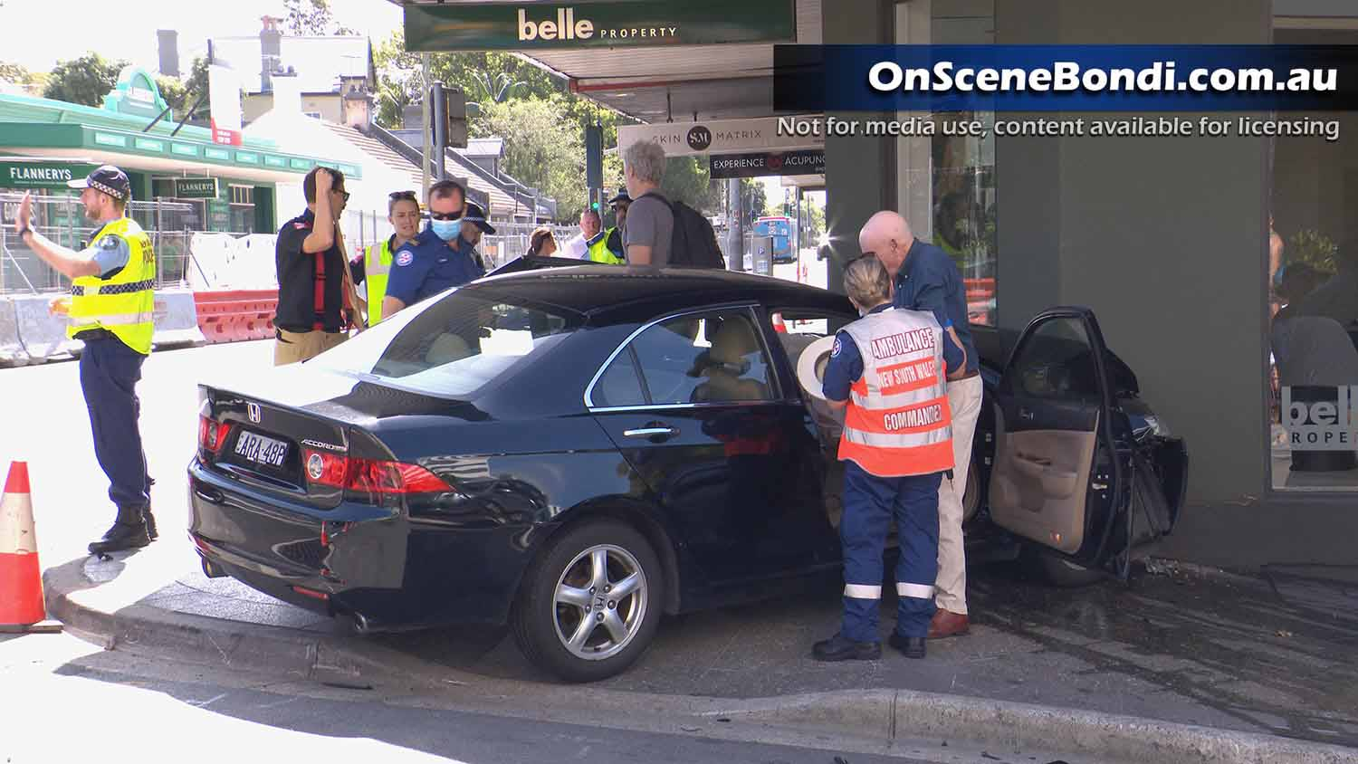 Car crashes into Bondi Junction shopfront after two car crash