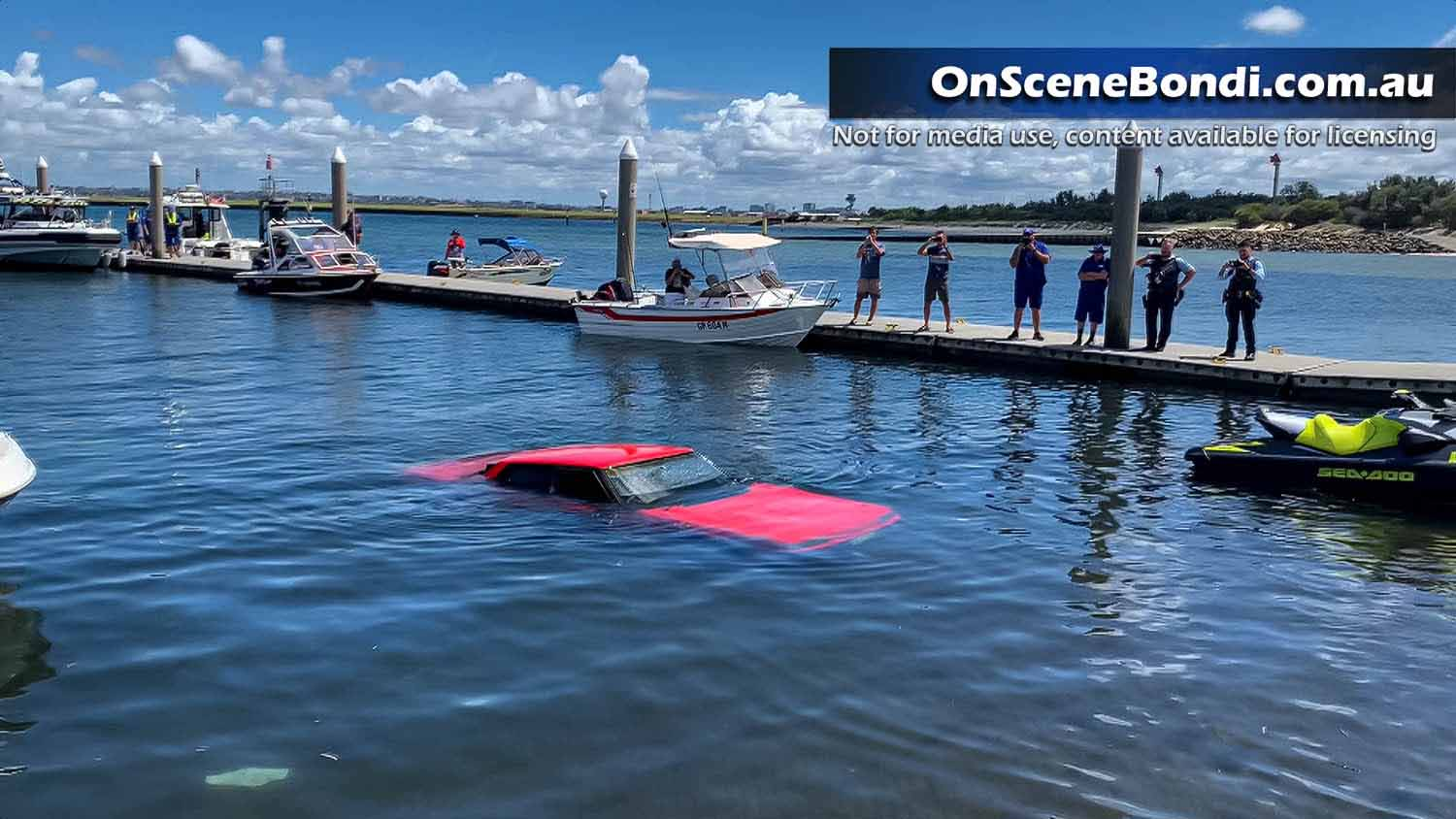 Car plunges underwater after losing traction at Botany Boat Ramp